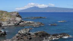 Ocean Rock Formations Tilt up to Volcano Stock Footage