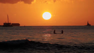 Stock Video Footage of Surfers & boats watching sunset on the ocean water waikiki 3