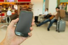 hand holding smartphone - stock photo