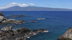 Volcano and Rocky Shore Tilt Up Stock Footage