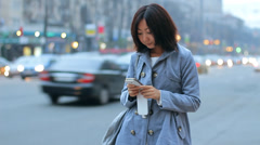 Asian Woman Talking Texting Cellphone Smartphone in Evening City HD - stock footage