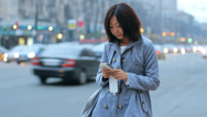 Asian Woman Talking Texting Cellphone Smartphone in Evening City HD Stock Footage