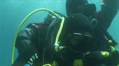 Two divers in an emergency Stock Footage