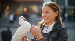 Beautiful, nice girl holding a dove Stock Footage