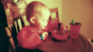 Stock Video Footage of a baby boy trying to eat stew