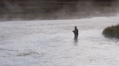 Fly Fisherman in Madison River in Yellowstone National Park - stock footage