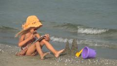 Girl Playing on tablet on Seashore, People, Children Stock Footage