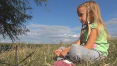 Sad, Bored Little Girl on Meadow by Lake, Not Playing Unhappy, Thinking Child - stock footage
