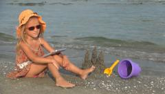 Child on Tablet on Beach, Little Girl Playing Ipod on Seashore, People, Children Stock Footage