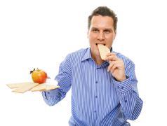 healthy lifestyle man eating crispbread and apple - stock photo
