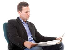businessman reading a newspaper isolated - stock photo