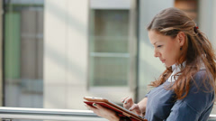 Young, attractive business woman with tablet computer in office building Stock Footage