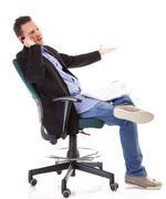 man reads newspaper phoning - economy news - stock photo