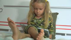 Little Girl, Child in Pajamas Playing on Wireless Tablet before Bedtime - stock footage