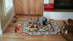 Baby boy playing in a living room jib shot Stock Footage