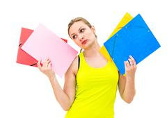 unhappy woman with folders - stock photo