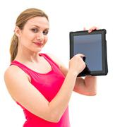 Woman holding in hand a tablet touch pad Stock Photos