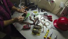 Electrician Working With Digital Multimeter Stock Footage
