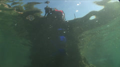 Diver jumps into the water Stock Footage
