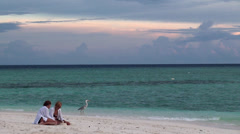 Two girls at the beach watching for the gray heron. Maldives. Stock Footage