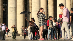 Stock Video Footage of A large group of Asian tourists next to St Peters columns