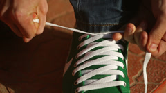 Tying a shoe - stock footage