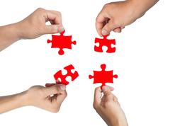 Hands and puzzle Stock Photos