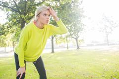 Active exhausted blonde pausing after running Stock Photos