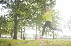 Stock Photo of Active pretty blonde jogging