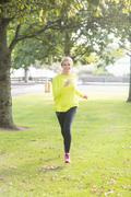 Stock Photo of Active smiling blonde jogging towards camera
