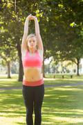 Active peaceful blonde doing yoga exercise Stock Photos