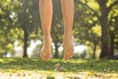 Close up of female feet jumping in the air Stock Photos