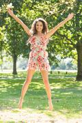 Stylish gorgeous brunette jumping in the air - stock photo