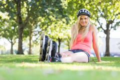 Casual happy blonde wearing roller blades - stock photo