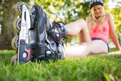 Stock Photo of Casual attractive blonde wearing roller blades
