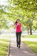 Stock Photo of Gorgeous sporty woman jogging in a park