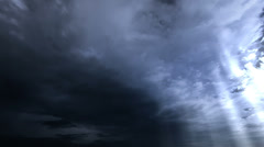Seamless loop of storm clouds with rays. Time-lapse motion background 1080p - stock footage
