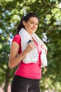 Stock Photo of Content sporty woman having a break