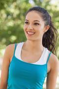Front view of joyful young woman wearing sportswear - stock photo