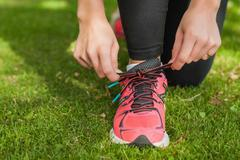 Stock Photo of Close up of sporty woman tying her shoelaces