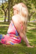 Stock Photo of Profile view of cute young woman enjoying the sun