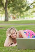 Cute woman posing on a lawn - stock photo