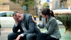 Attractive businesswoman consoling her worried colleague HD - stock footage