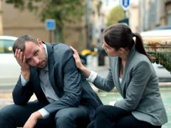 Attractive businesswoman consoling her worried colleague NTSC - stock footage