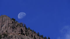 Moon Setting over Baronette Peak in Yellowstone National Park Stock Footage