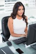 Stock Photo of Calm cute businesswoman working at computer