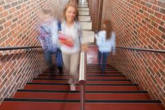 Students climbing stairs - stock photo