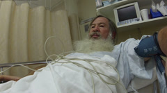 Man with big beard hospital recovery bed surgery HD 0177 Stock Footage