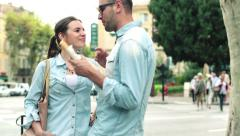 Couple meeting on city street and shering baguette HD Stock Footage