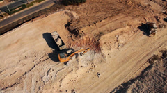 Excavator  Loading sand to a Truck- Aerial  top shot Stock Footage
